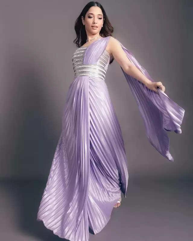 PHOTOS:- Tamannaah Bhatia showed her stylish look in a purple dress!